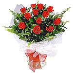 A beautiful arrangement of roses and greens. An orchestra of 19 fabulous roses....
