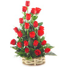 The long stem first class 20 red roses with assorted greenery in hand-tied. It i...